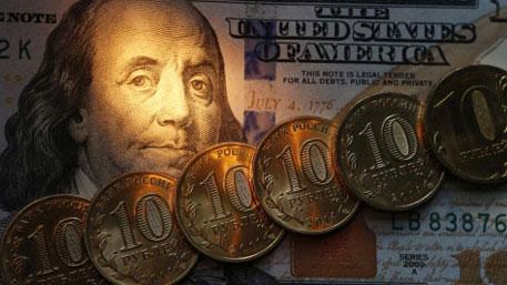 Рубль замедлил падение после заявлений Путина по нефти