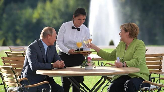 Необычные визиты Владимира Путина в Австрию и Германию