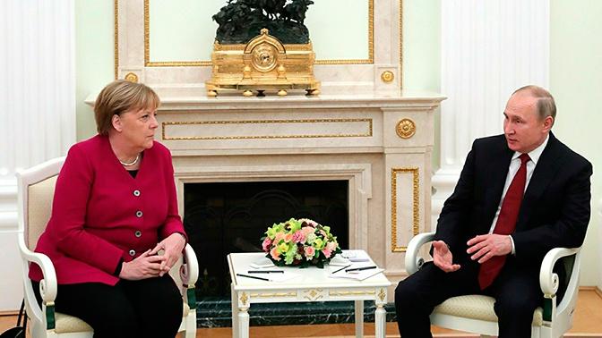 Путин и Меркель обсудили вопросы, связанные с Международной конференцией по Ливии